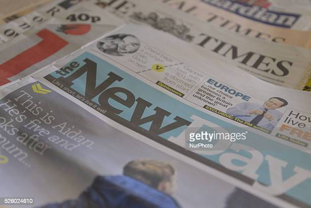 Light shining on the front page of the new newspaper The New Day on its first day of publication in Stockport Greater Manchester England United...