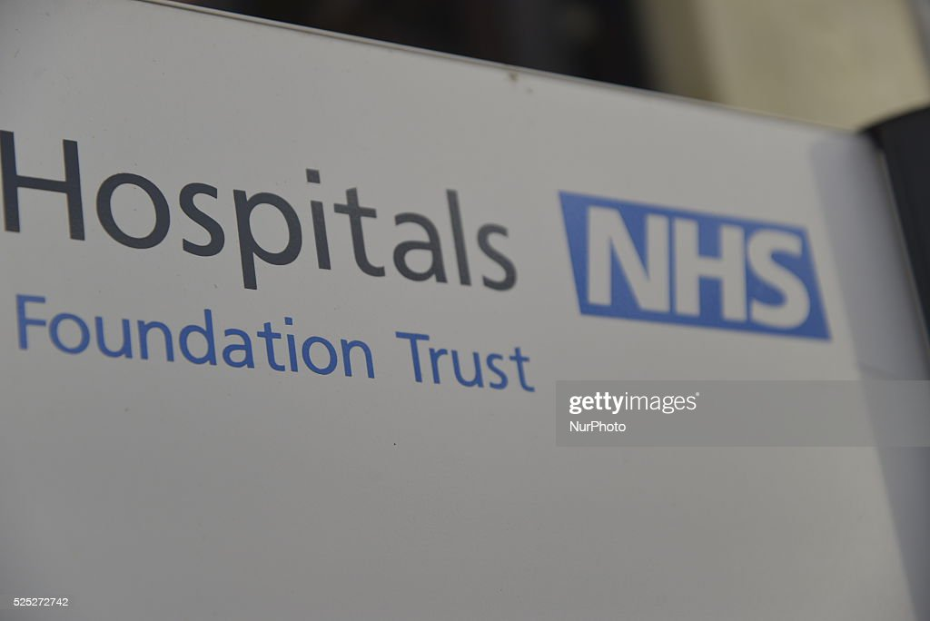 Light shining on the National Health Service logo at Manchester Royal Infirmary University Hospital in Manchester on Friday 11th December 2015. A new National Health Service mental health inspectorate in England to be introduced by Jeremy Hunt. This is in the wake of the Southern Health Foundation Trust scandal, where the deaths of people suffering from mental illness, and learning difficulties, were not properly investigated. One in four people will suffer from mental health problems in the United Kingdom at some stage in life.