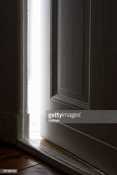 light shining through a door left ajar - magic doors stock pictures, royalty-free photos & images