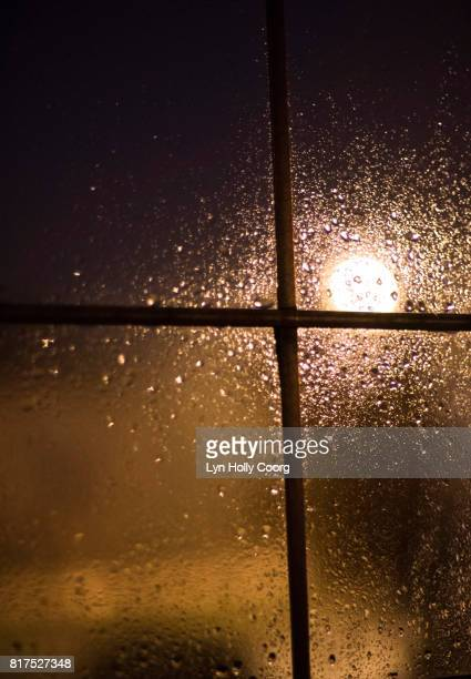 light shining through a wet paned window - lyn holly coorg stock pictures, royalty-free photos & images