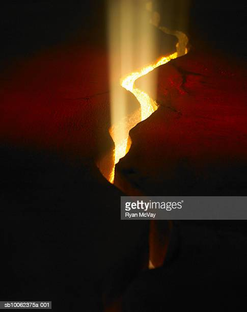Light shining through crack in lava rock, elevated view