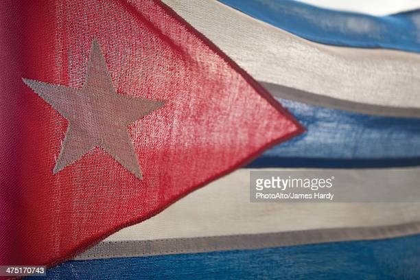 light shining through cuban flag, full frame - cuban flag stock pictures, royalty-free photos & images