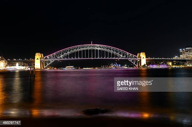 A light show called 'Vivid' is performed on the Sydney Opera House and Harbour Bridge in Sydney on May 23 2014 'Vivid' is a major annual outdoor...