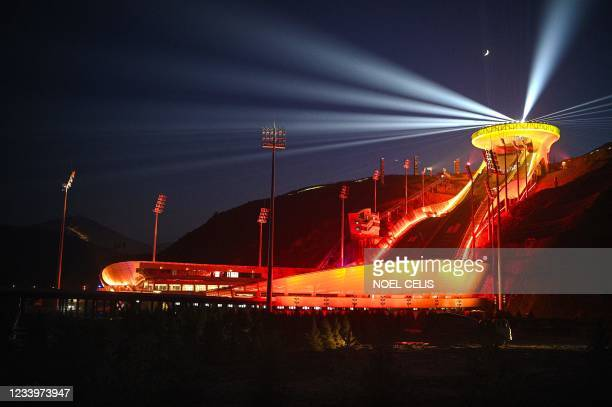 Light show display is seen at the National Ski Jumping Centre for the Beijing 2022 Winter Olympic Games in Zhangjiakou in northern China's Hebei...