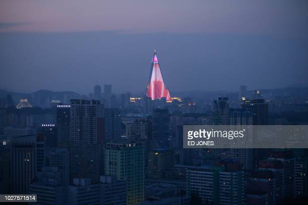 A light show is displayed on the Ryugyong hotel amid the city skyline of Pyongyang on September 6 2018 North Korea is preparing to mark the 70th...