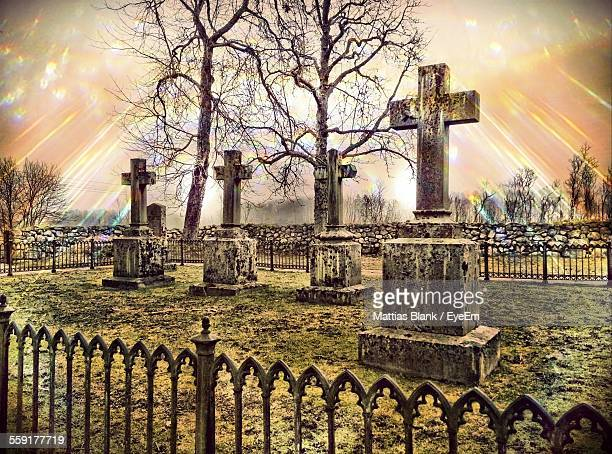 Light Showered On Tombstones At Cemetery