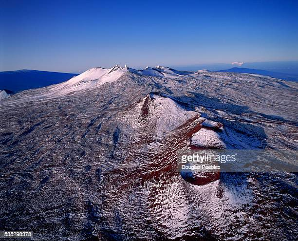 A light snowfall covers Mauna Kea considered to be the largest mountain in the world as well as an active volcano on the Big Island of Hawaii