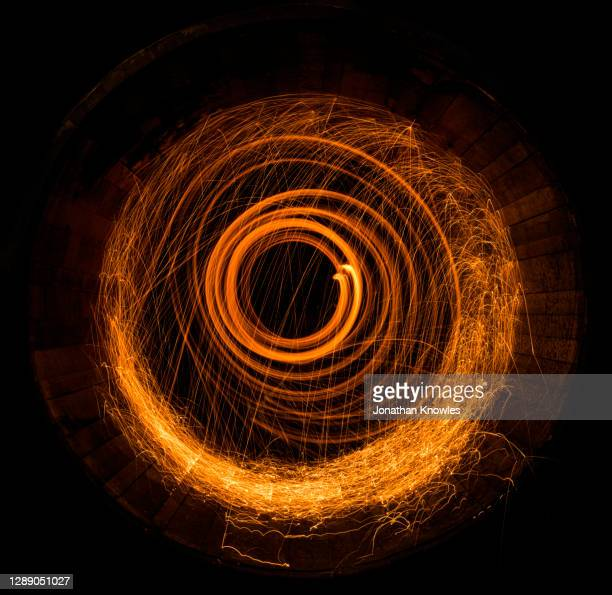 light sparks swirling in barrel - blurred motion stock pictures, royalty-free photos & images