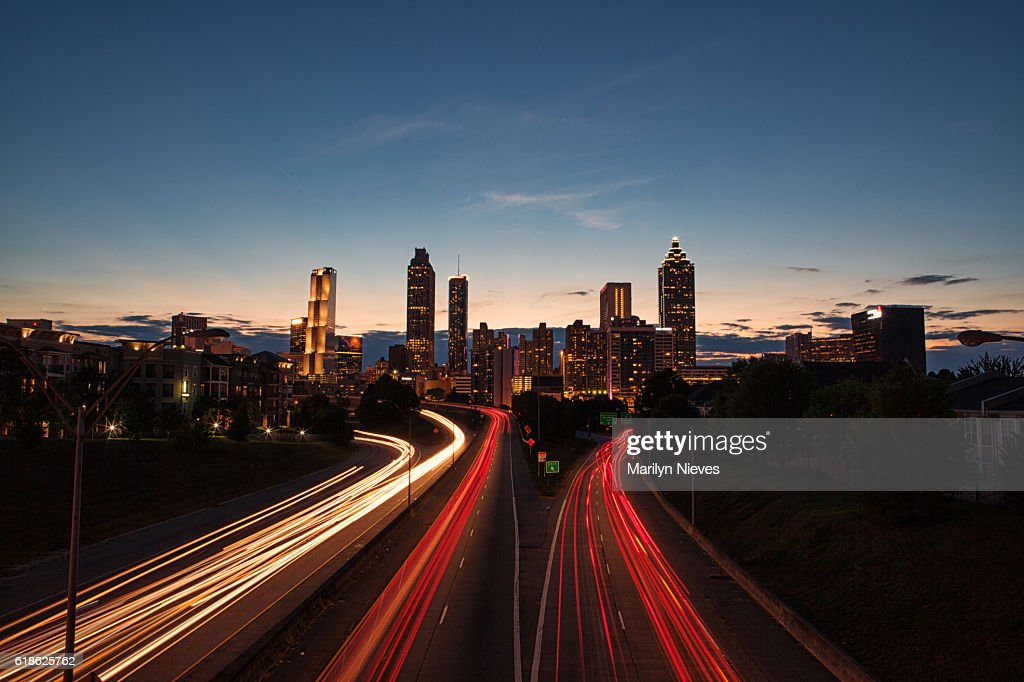 Light streaks through the Atlanta highways at blue hour : Stock Photo