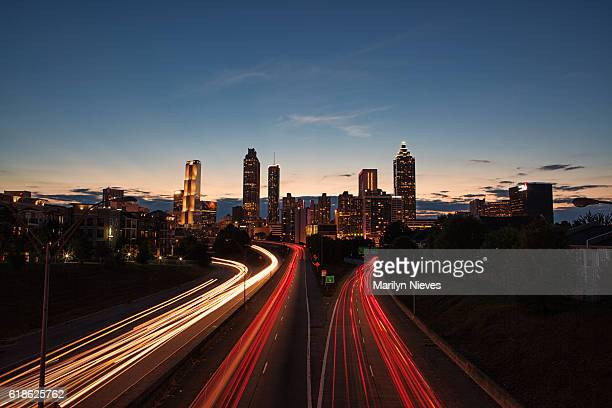 light streaks through the atlanta highways at blue hour - atlanta skyline stock pictures, royalty-free photos & images