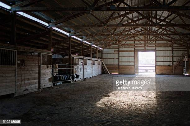 Light streaming into barn from open doorway