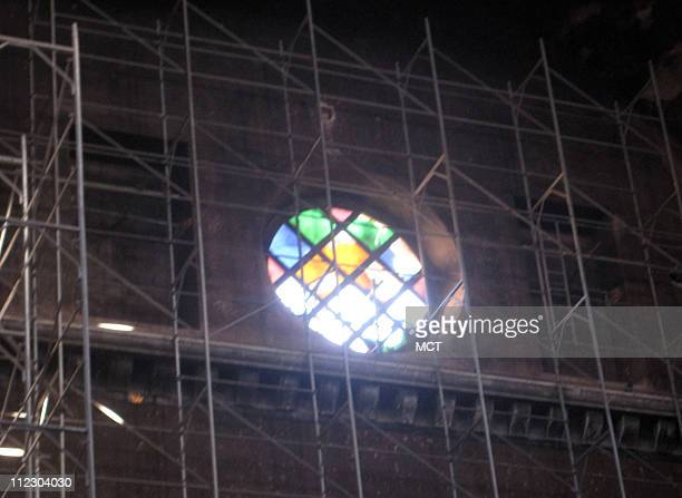 Light streams through one of the remaining stainedglass windows illuminating the interior of the Benghazi Cathedral Once a huge indicator of...