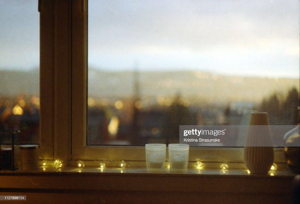 light string in a windowsill : Stock Photo