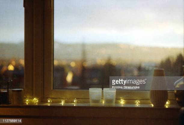 light string in a windowsill - hygge stock pictures, royalty-free photos & images