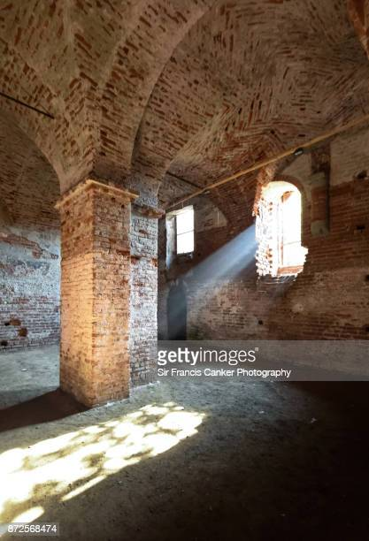 Light sunbeams through the window inside Staffarda Abbey in Revello, Piedmont, Italy