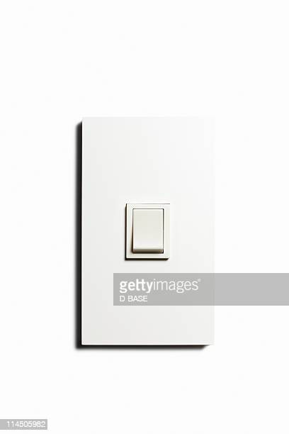 Light switch on  the white wall