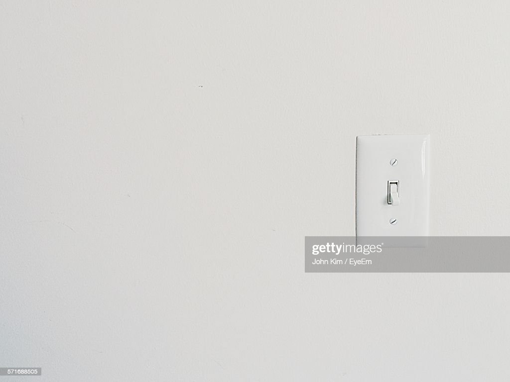 Light Switch On Wall Stock Photo | Getty Images