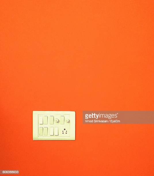 Light Switches Mounted On Orange Wall