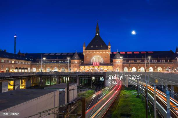 light tail from train run into Copenhagen central station in Denmark with clear blue sky