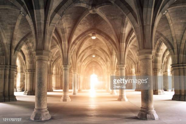 light through the arch - corridor stock pictures, royalty-free photos & images
