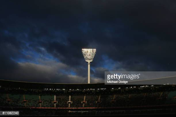 A light tower shines bright in the late evening sun during the round 16 AFL match between the Carlton Blues and the Melbourne Demons at Melbourne...