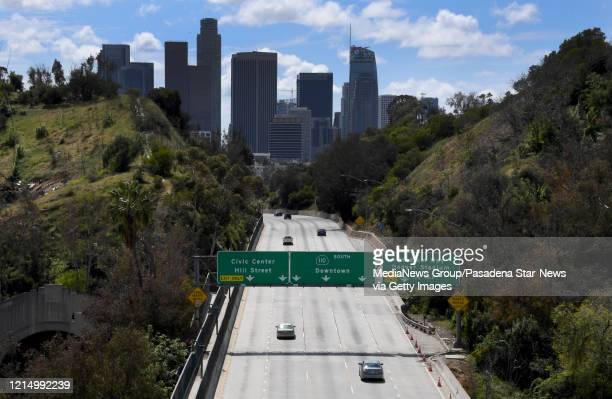 Light traffic heads toward downtown on the 110 freeway in Los Angeles on Wednesday, March 25, 2020.