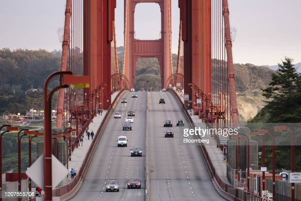 Light traffic moves along the Golden Gate Bridge during rush hour in San Francisco, California, U.S., on Friday, March 20, 2020. California Governor...