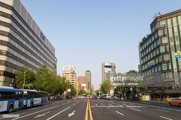 Light traffic on the Jongno ('Bell Street') thoroughfare in the central Seoul, South Korea, viewed from the middle of the street.