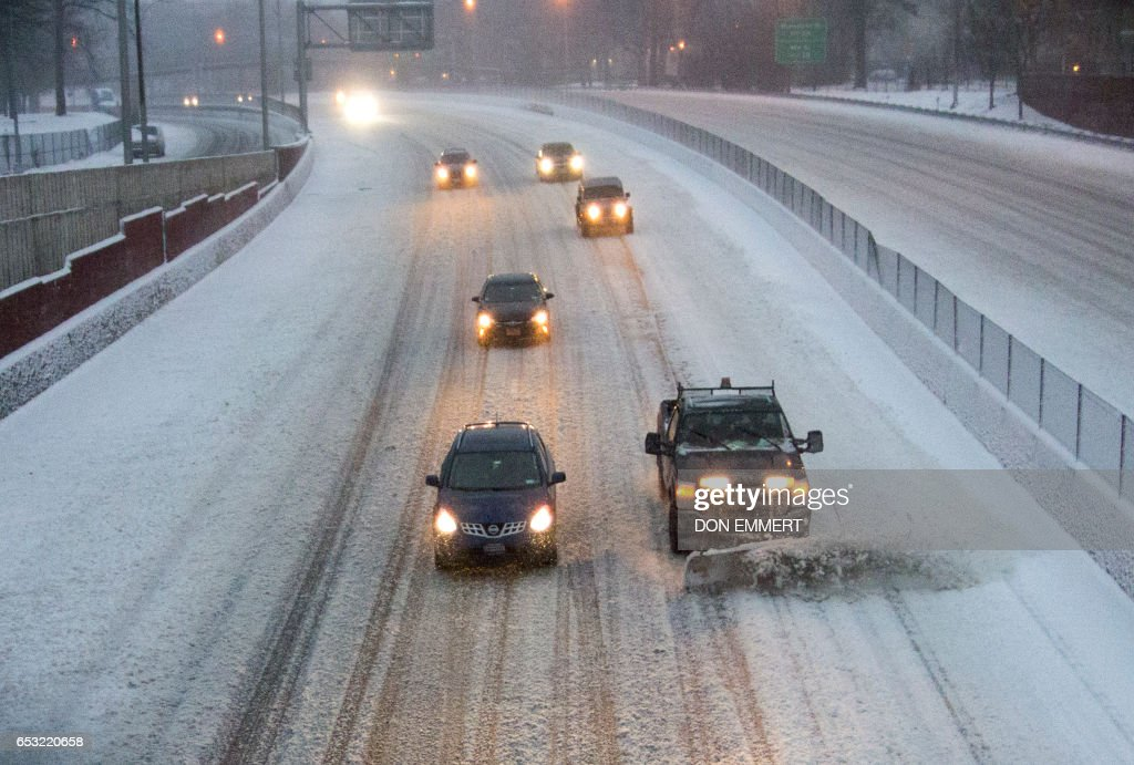 Light traffic travels on Northbound Interstate 95 in the Bronx Borough March 14, 2017 in New York. Winter Storm Stella dumped snow and sleet Tuesday across the northeastern United States where thousands of flights were canceled and schools closed, but appeared less severe than initially forecast. After daybreak the National Weather Service (NWS) revised down its predicted snow accumulation for the city of New York, saying that the storm had moved across the coast. EMMERT