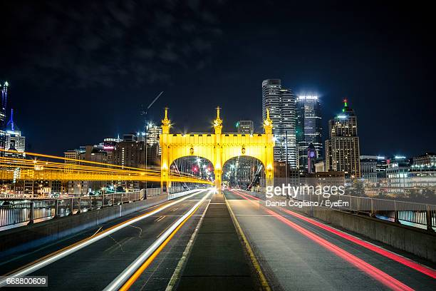 light trail at smithfield street bridge against sky - pittsburgh stock pictures, royalty-free photos & images
