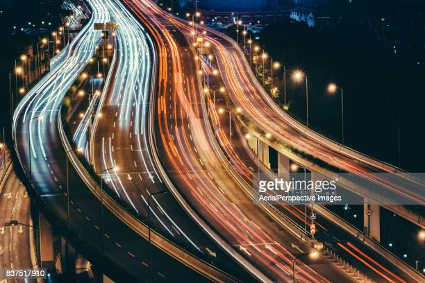 light trail of shanghai highway at night - long exposure stock pictures, royalty-free photos & images