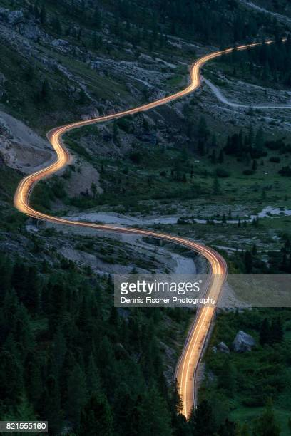 Light trail on curvy road in the Dolomites