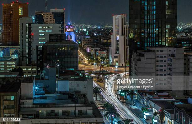 Light Trail On Street Amidst Buildings In City