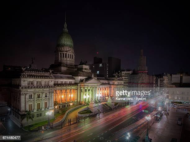 light trail on street by national congress of argentina against sky at night - politics and government stock pictures, royalty-free photos & images