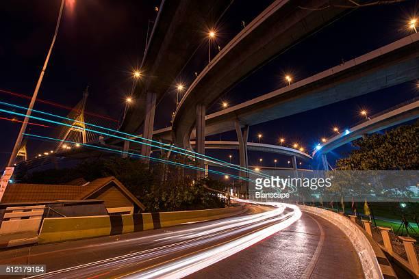 Light trail on street under Bhumibol Bridge in Bangkok, Thailand.
