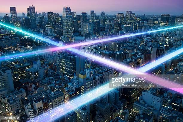 Light trails above buildings