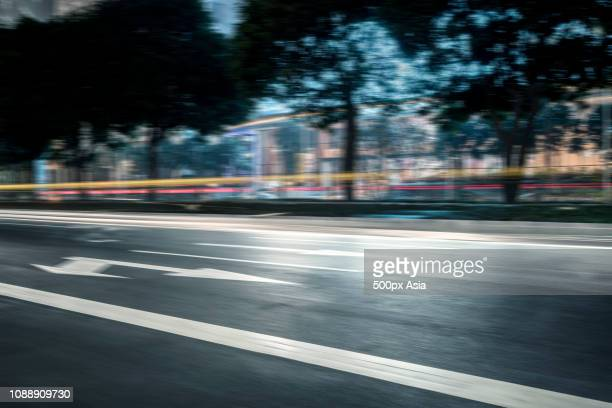 light trails along urban road, guangzhou, guangdong, china - image stockfoto's en -beelden
