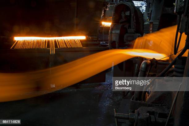 Light trails are seen as a metal billet moves during the forging process in this long exposure photograph taken at the Vaughan Bushnell Manufacturing...