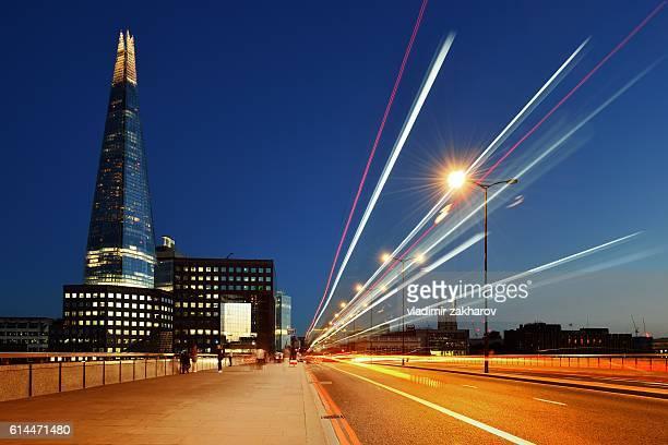 light trails at london bridge - london bridge stock photos and pictures