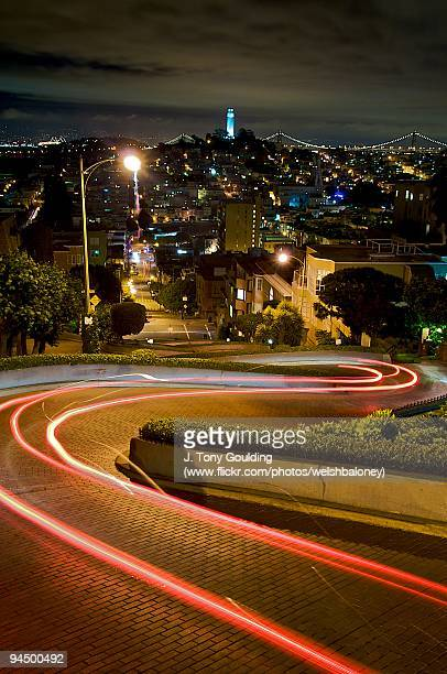 light trails at night, lombard street - lombard street san francisco stock pictures, royalty-free photos & images