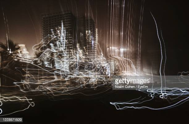 light trails at night - noam cohen stock pictures, royalty-free photos & images