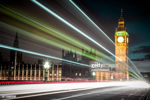light trails at night with parliament building and big ben, london, uk - brexit stock pictures, royalty-free photos & images