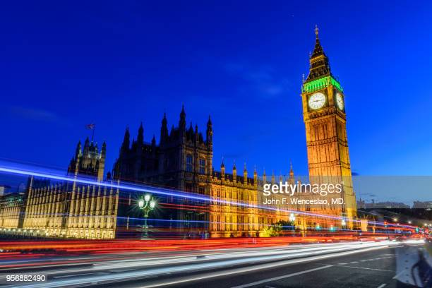 light trails by big ben - big ben stock pictures, royalty-free photos & images