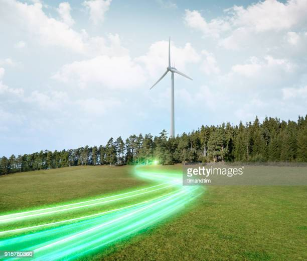Light trails coming from a wind turbine in the forest
