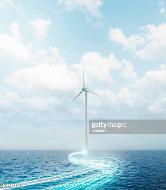 Light trails coming from a wind turbine in the sea