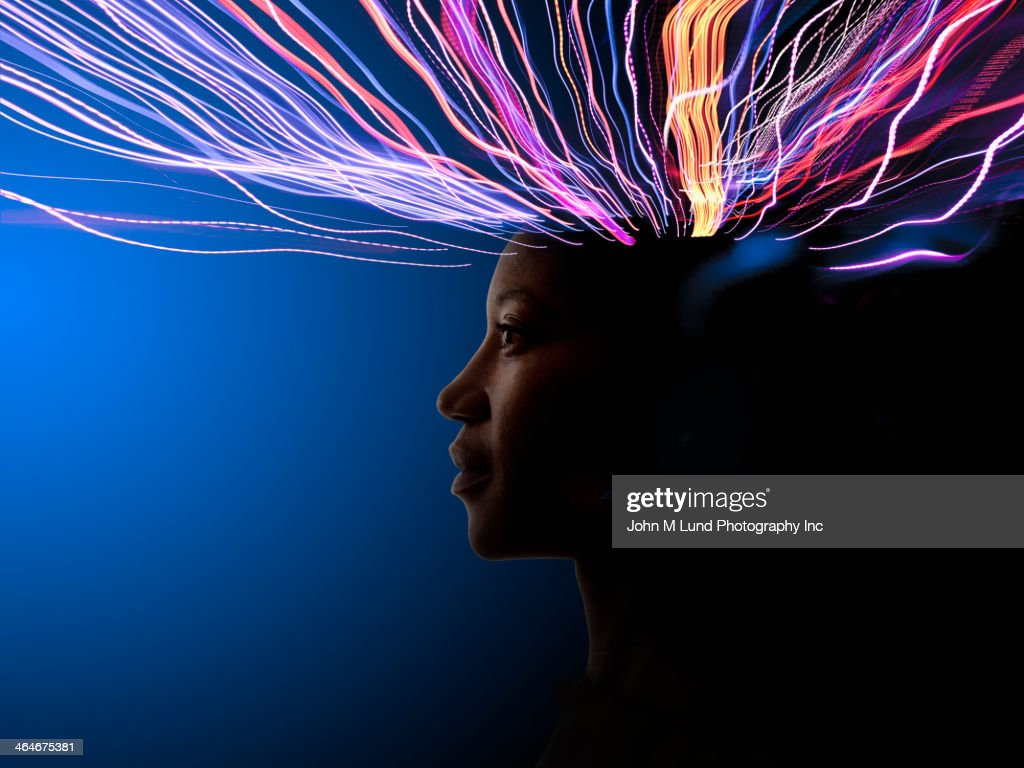 Light trails coming from African American's head : Stock Photo