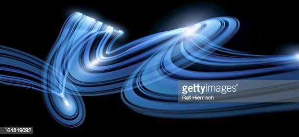 Light trails creating an abstract blue swirling pattern on a black background