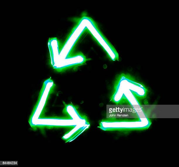 light trails forming  signs recycling symbol