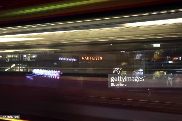Light trails from a bus pass in front of a Raiffeisen Schweiz Genossenschaft bank branch in Bern Switzerland on Tuesday Nov 7 2017 Switzerland's...