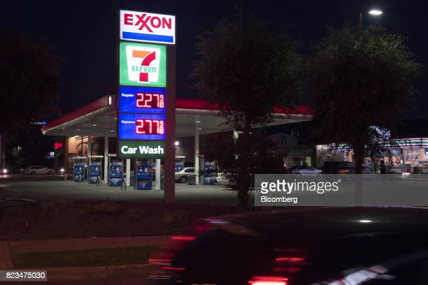 Light trails from a moving vehicle are seen in front of an Exxon Mobil Corp gas station in Dallas Texas US on Monday July 24 2017 Exxon Mobil Corp is...